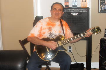 THE DIRTY ROCKER, by SAM SCOLA SONGS on OurStage