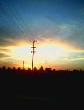 sunshine and telephone wires, by Melanie Darnall on OurStage